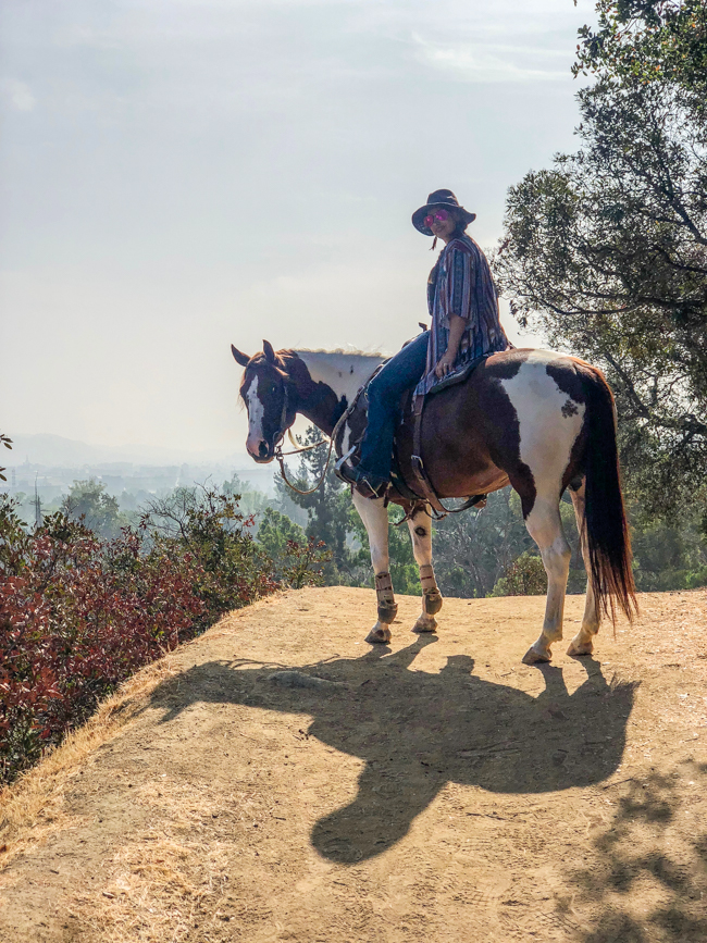 horseback riding through the hills in Los Angeles