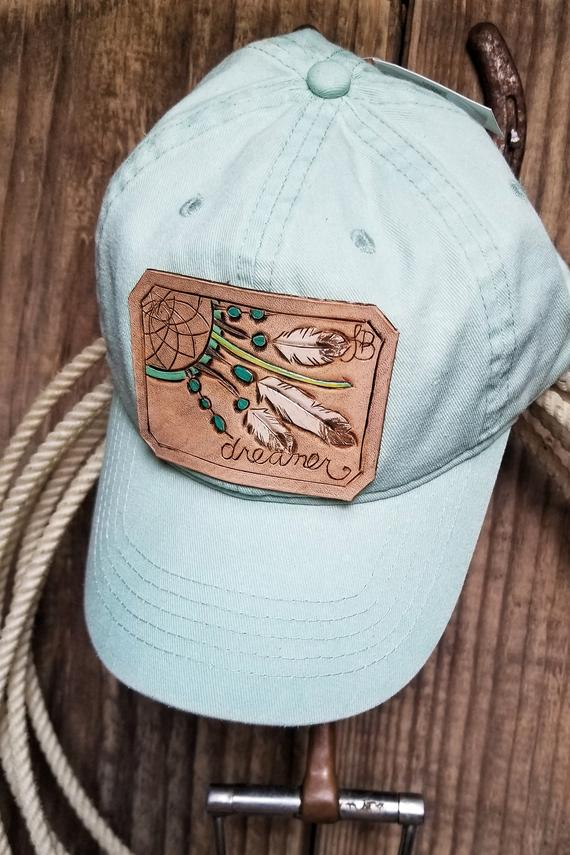 womans hat with leather patch